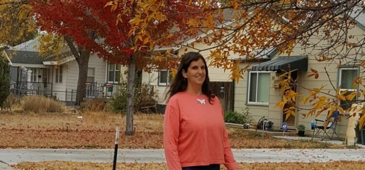 Amy Bovairds Friday Friends with Jo Pinto. Image is of Jo walking outside in the Fall with beautiful red, orange and yellow leaves on the trees and ground.