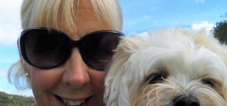 Amy Bovairds Friday Friends with Jackie Meek. Picture is a closeup of Jackie and her cute, white fluffy dog!