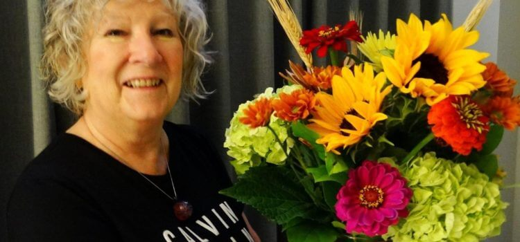 Amy Bovairds Friday Friends with Lynda Lambert holding a beautiful, bright, cheerful bouquet of flowers.