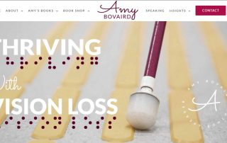 Screenshot of Amy Bovairds new website home page showing tactile concrete, cane and the words Thriving With Vision Loss in english and in braille.