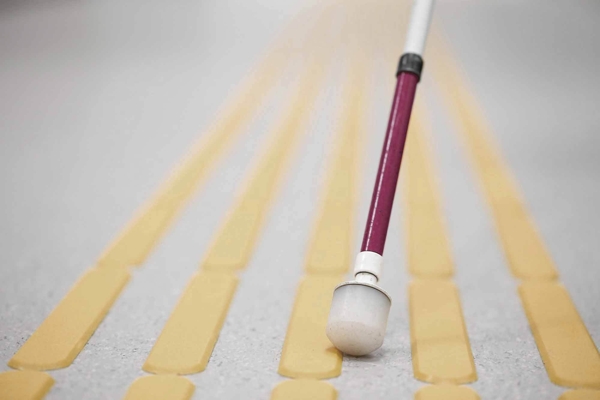 Landing page image of tactile paving, cane and Amys tag line of Thriving With Vision Loss