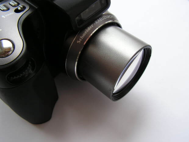 Amy Bovaird - Zooming in on the Positive - a closeup picture of a camera