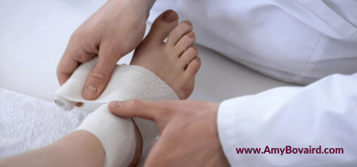Don't Let Mobility Mishaps Deter You - sprain image doctor wrapping ankle