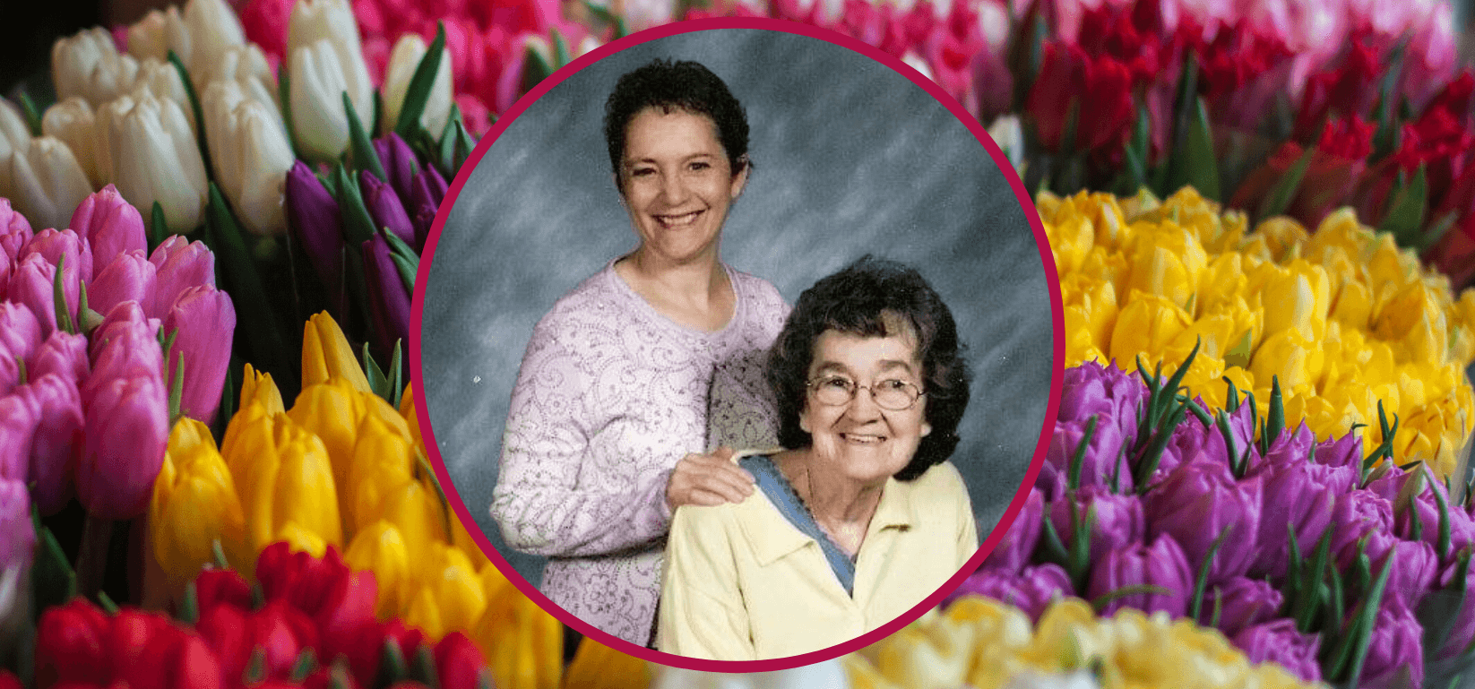 Image of Amy Bovaird and her Mom surrounded by tulips