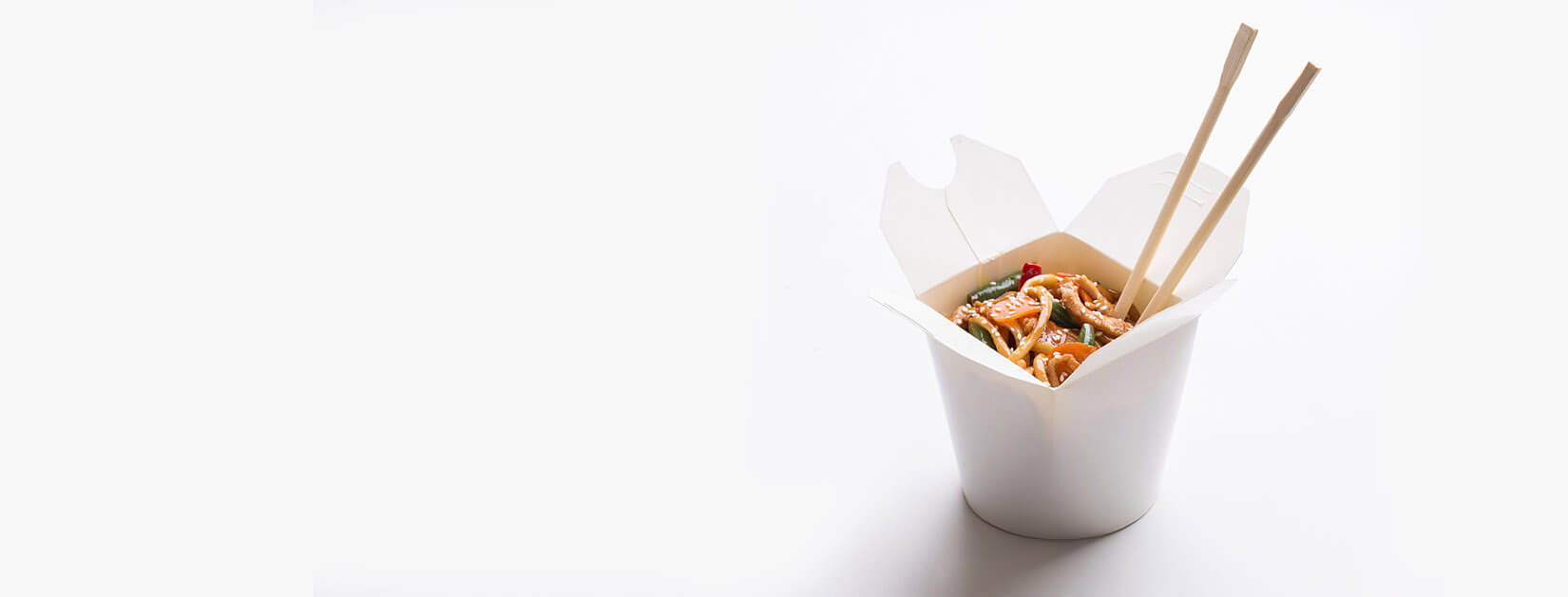 chinese food in a take out container with chopsticks during Covid-19