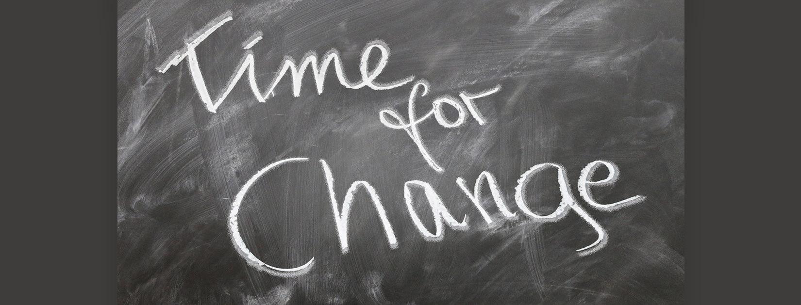 time for change written on a chalkboard