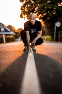 Morten Bonde squating down over a white line