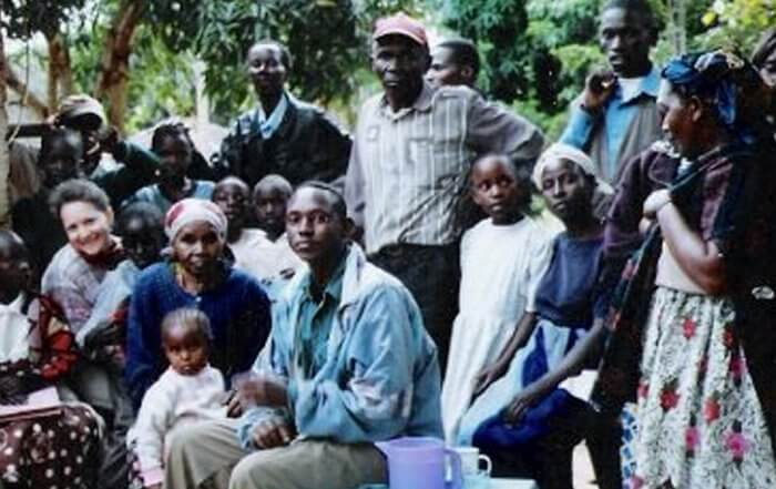 amy bovaird with a group of local people in kenya