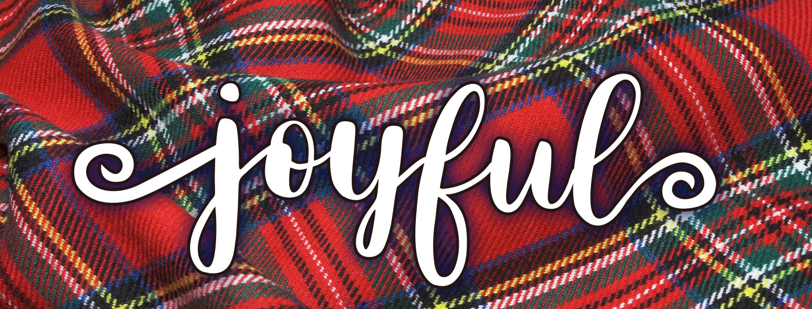 the word joyful on top of tartan plain fabric background